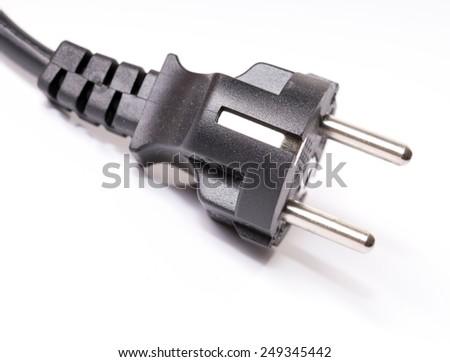 Power plug on a grey underground / Power plug - stock photo