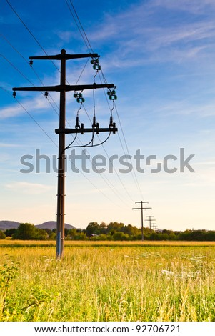 Power pole at dawn - stock photo