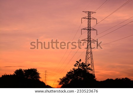 Power Pole. Electricity Pylons in the Setting Sun of Dusk - stock photo