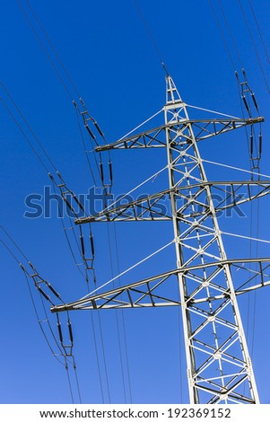 power pole on blue sky high voltage electricity production