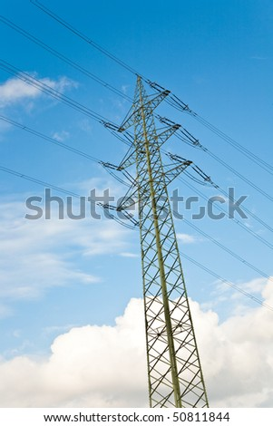 power pole  with blue sky background and white clouds