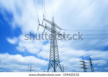 power pole with dynamic blue cloudy sky - stock photo