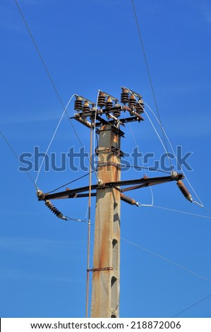 Power pole with external electric separator on top  - stock photo