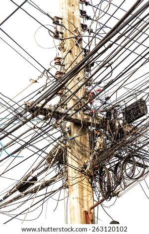 Power pole with Tangle of Electrical wires. - stock photo