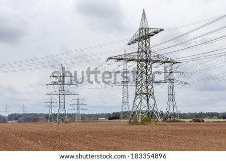Power poles of a power line - stock photo