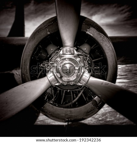 Power propeller on an old air force plane radial aircraft engine power plant in vintage grunge monochrome sepia - stock photo