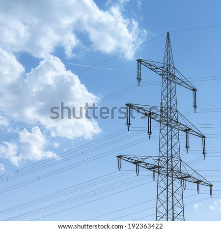 Power pylon on blue sky with clouds energy electricity