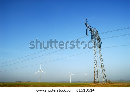 Power pylons and grid - stock photo