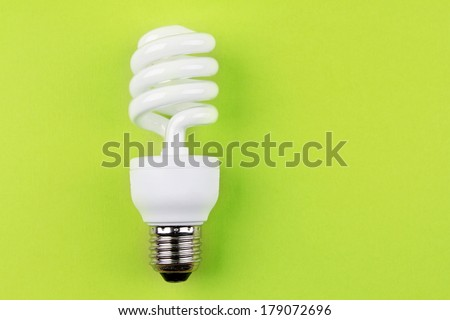 Power saving light bulb on green - stock photo