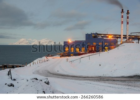 Power station in Barentsburg - Russian village on Spitsbergen, Norway. - stock photo