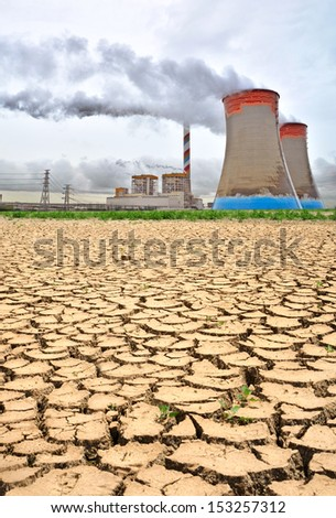 power station with cooling towers releasing steam  - stock photo