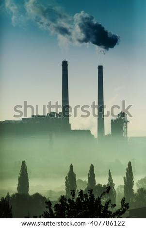 Power station with smoking chimney - stock photo