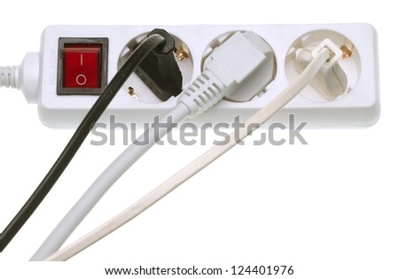 Power strip with multiple electrical cords plugged in - stock photo