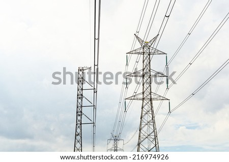 Power transmission lines against blue sky / Power transmission lines  - stock photo