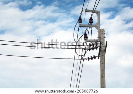 Power transmission lines (22 kV System) against blue sky / Power transmission lines  - stock photo