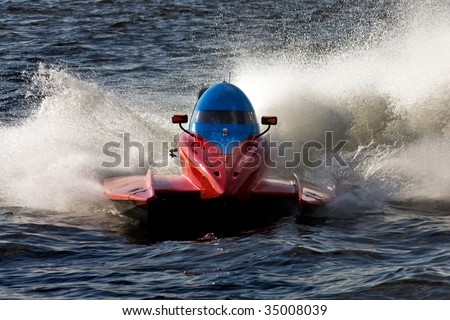 Powerboat rushing on the water during the race - stock photo