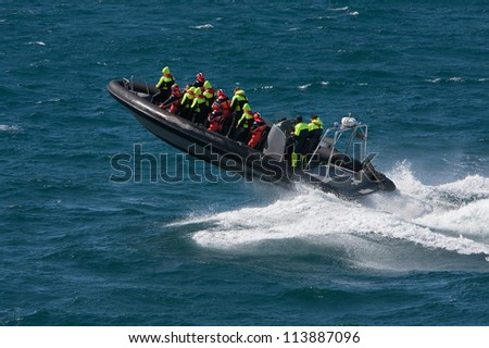 Powerboat with tourists from Alesund (Norway) - stock photo