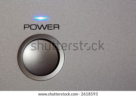 Powerbutton - close-up. Copyspace on grey/silver front. - stock photo