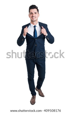 Powerful and confident young businessman opening his suit jacket as superhero metaphor - stock photo