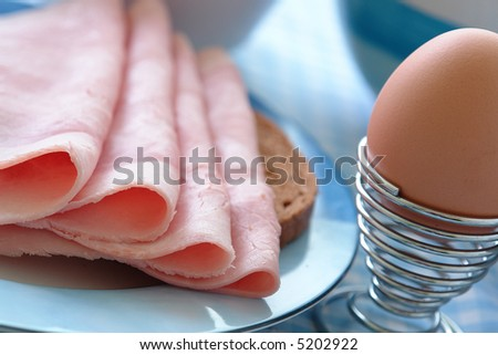 Powerful breakfast with a loaf of bread and ham and eggs - stock photo