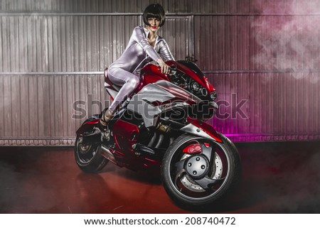 Powerful brunette woman wearing latex mounted on a motorcycle with a modern design - stock photo