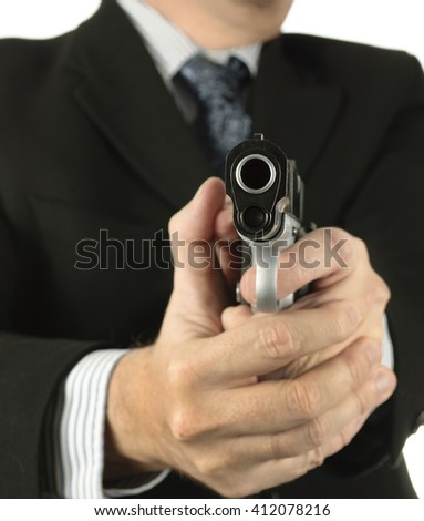 Powerful businessman points a gun - stock photo