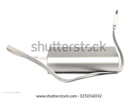 powerful external battery with USB wire - stock photo