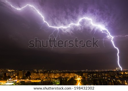 Powerful lightning over night city - stock photo