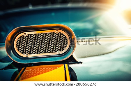 Powerful muscle car. Closeup photo of the hood - stock photo
