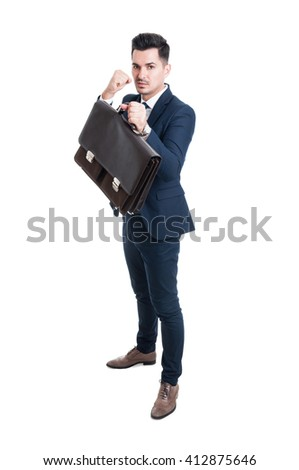 Powerful salesman or consultant standing ready to fight with fists isolated on white background