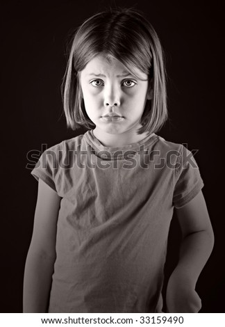 Powerful Shot of a Sad Looking Blonde Child - stock photo