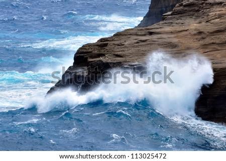 Powerful waves crashing against the rocks - stock photo
