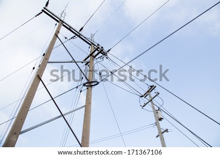 Powerlines against a background of the sky - stock photo