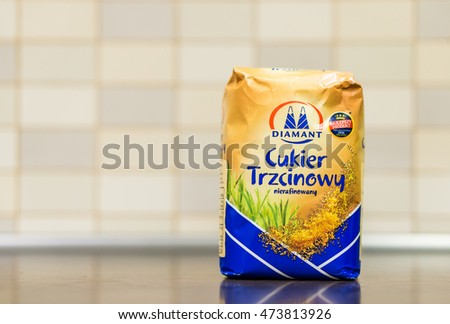 POZNAN, POLAND - AUGUST 25, 2016: Diamant brown sugar in a paper pack on wooden table