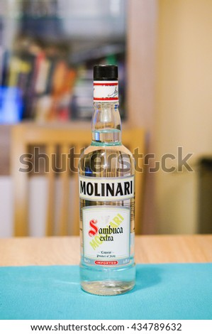 POZNAN, POLAND - AUGUST 16, 2015: Sambuca drink Molinari in a glass bottle on table  - stock photo