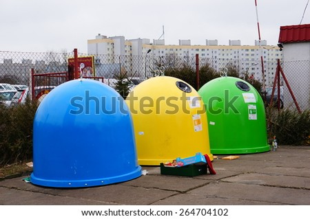POZNAN, POLAND - JANUARY 25, 2015: Row of sorted trash containers - stock photo