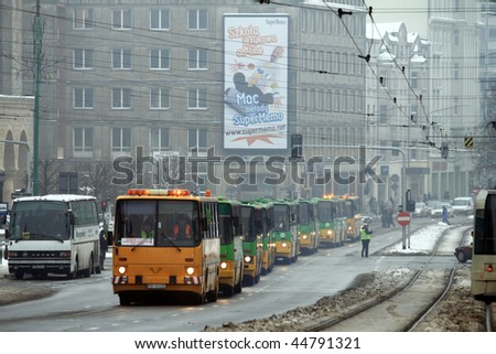 POZNAN, POLAND - JANUARY 16: Solemn farewell of high-floor buses in the parade, combined with the celebration of 85 years of bus service on January 16, 2010 in Poznan, Poland