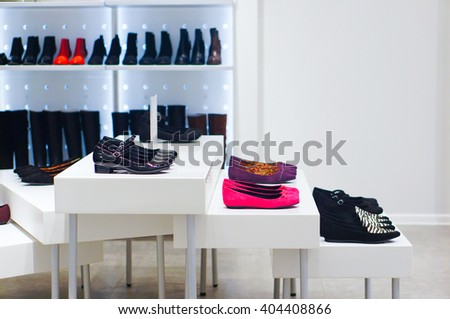POZNAN, POLAND - JANUARY 19, 2014: Variation of shoes for sale in a shoe store