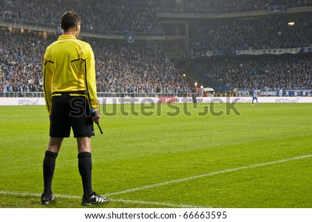 POZNAN, POLAND - JULY 4, European League group match Lech Poznan - FC Manchester City 3-1, fourth and fifth referees in European League, on July 4, 2010 in Poznan, Poland - stock photo