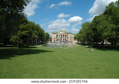 Poznan, Poland - July 13, 2014: Unidentified people in park at Stanislaw Moniuszko Theater in Poznan, Poland.