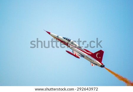 POZNAN, POLAND - JUNE 13-14, 2015: Aerofestival 2015, acrobatic team Turkish Stars perform at the Aerofestival airshow in Poznan - Lawica. F-5 Freedom Fighter. - stock photo