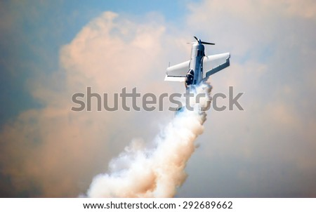 POZNAN, POLAND - JUNE 13-14, 2015: Aerofestival 2015, aerobatic pilot Jurgis Kairys perform at the Aerofestival airshow in Poznan - Lawica. SU-31.  - stock photo
