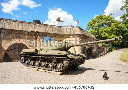 POZNAN, POLAND - JUNE 12, 2016: Old tanks standing by the entrance of a war museum on the Citadel park  - stock photo