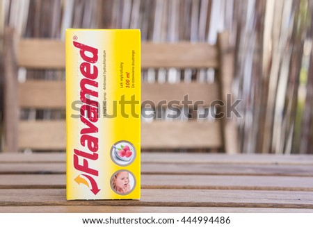 POZNAN, POLAND - JUNE 28, 2016: Pack of Polish Flavamed syrup on wooden table