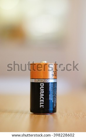 POZNAN, POLAND - MARCH 02, 2016: One Duracell battery standing on wooden table - stock photo