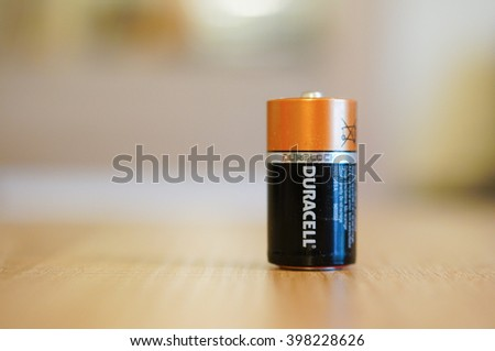 POZNAN, POLAND - MARCH 02, 2016: One Duracell battery standing on wooden table