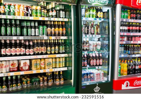 POZNAN, POLAND - MAY 20, 2014: Beers for sale in a fridge at a supermarket - stock photo