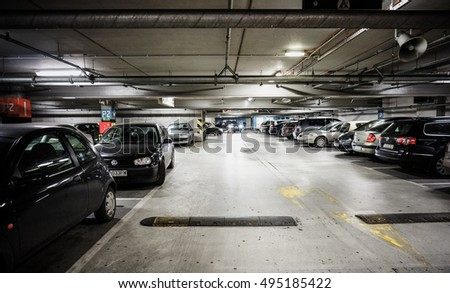 POZNAN, POLAND - NOVEMBER 29, 2013: Many parked cars in a parking garage of the Poznan City Center shopping mall