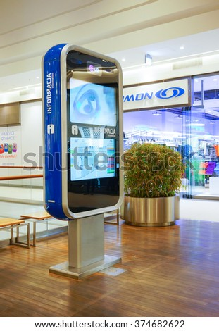 POZNAN, POLAND - OCTOBER 31, 2013: Digital map and information board in the Galeria Malta shopping mall - stock photo