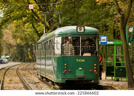 POZNAN, POLAND - SEP 25, 2014: Duwag GT8 tram model produced in the years 1957 to 1976 by the German company Waggonfabrik Dusseldorf. Tramway in the colors of MPK Poznan. - stock photo